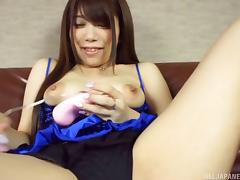 Soft lingerie is sexy on a solo cutie vibrating her Asian pussy