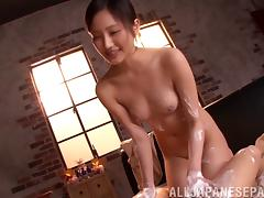 Salacious Japanese beauty blows a cock nicely and rides it till she gets facial cumshot