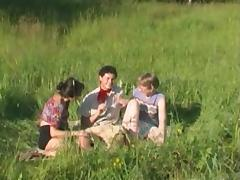 Mature ladies utterly devour his dick in a grassy field