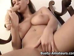Busty Sara mastubates her pussy with dildo