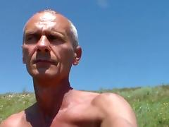 Amateur gay porn shows old dude posing in the outdoors