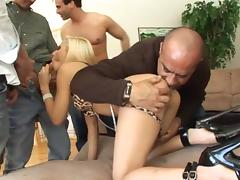 Flexible slut lets a bunch of guys fuck her at once