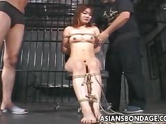 Skilled master ties his Asian slave up and suspends her