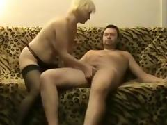 Mature blonde makes a kamasutra sextape with her man on the sofa
