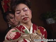 Mature Japanese wife in a kimono submits to hot bondage