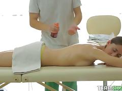 During the massage he slips her panties off so he can slide his dick in