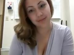 Bosomy chick kneads and sucks her lactating boobs in front of a webcam