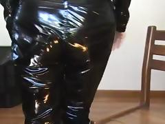 Lady in vinyl pants and jacket