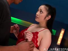 Pretty Japanese girl sucks his cock and licks his balls