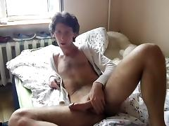 Comely fagot is beating off in the guest room and shooting himself on web camera