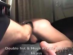 Two fists & Plastic Bottle in Ass