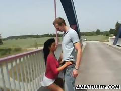 Busty German Milf sucks and fucks outdoor on a bridge