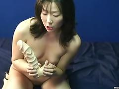 Brunette Asian sweet heat toys her tender holes