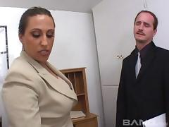 After motorboating his boss he fucks her hard on his desk