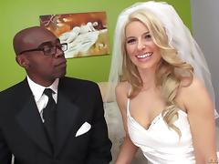 Smooth blonde in a wedding dress receives black dick straight into ass