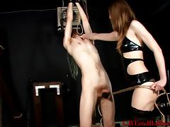 Lingerie-clad brunette with a great ass torturing a stranger