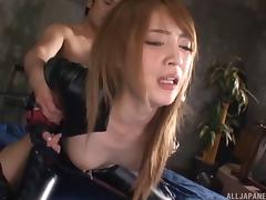 Leather wearing Japanese babe is unzipped, licked and fucked