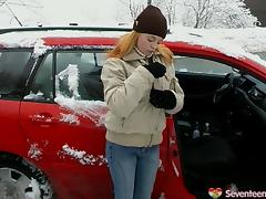 In a snowstorm Tanya fucks herself with a dildo out in her car