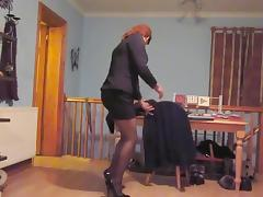 Wearing a sexy black mini skirt suit