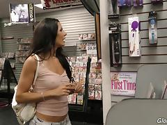 Whore at the porn store sucks off a big black gloryhole cock