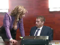 Fantastic blonde secretary relaxes a colleague by giving him a blowjob