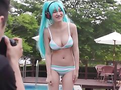 Japanese cosplaying babe with blue hair blows two guys at once