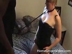 Black guy keeps his white bitch on a leash while fucking her mouth