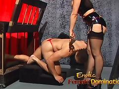 Mistress Natasha Sweet has fun with her helpless caged slave