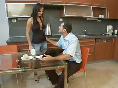 Sexy brunette with natural tits seduces guy to fuck her in ther kitchen