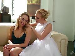 Pretty girl in a bridal gown fucks a sexy blonde lesbian