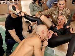 Slut in ripped leather pants fucked as a group of people watch
