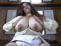 Fat chick in stockings shows her huge breasts and masturbates the cunt