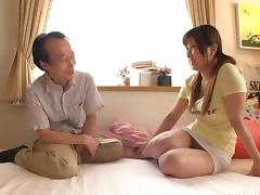 Pigtailed Japanese girl jerks off the old guy and fucks him