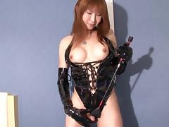 Black latex is shiny and amazing on a Japanese tranny
