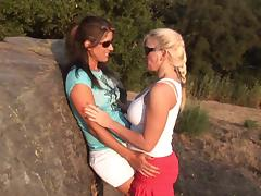 Lovely lesbian couple gets on heat at the field and rushes to neutralize the fuzzy feeling