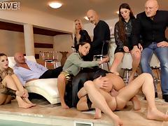 Party people watch these two girls blow and fuck a guy