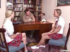 Two blonde teens in plaid skirts fuck a teacher