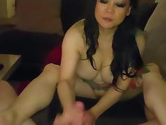 Tattooed asian fucking and sucking cock