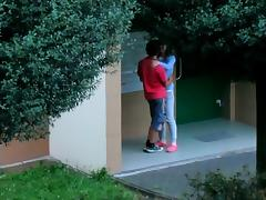 Beautiful college girl college girl  couple kissing cuddling and caressing outside
