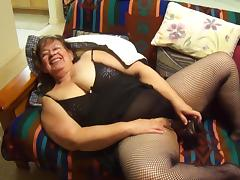 Granny sucking dick and playing with a toy