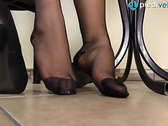 Kinky redhead puts on the pantyhose and exhibits her sexy feet