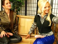 Two girls dominate another chick and fuck her with a strapon