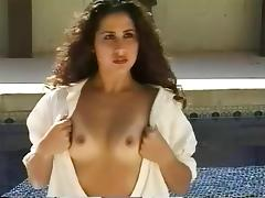Curly girl gets into the pool and exposes her sexy ass to the camera