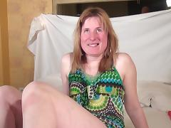 Dutch housewife pushes the dildo deep into her shaved snatch