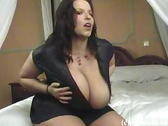 Big beautiful woman with huge natural tits touching her hot body