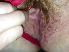 Hairy redhead showing her wet slimy pussy (close-up)