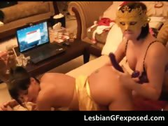 Kinky lesbian babe in mask strap
