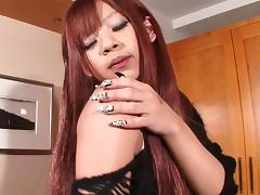 Asian tranny redhead fucked anally by an eager guy