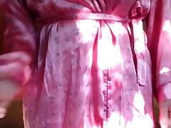 Taking pink dressing gown and my black pants off
