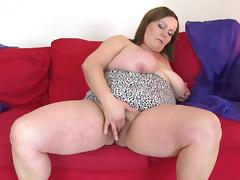 Captivating matured bbw fondling her big tits seductively indoors